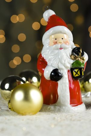 Santa Claus and christmas bauble with lights in background Stock Photo - 5967964