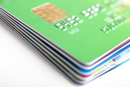 Stack of credit cards with shallow DOF, green card on top.