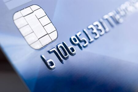 bankcard: Details of a credit card with chip and numbers, shallow DOF