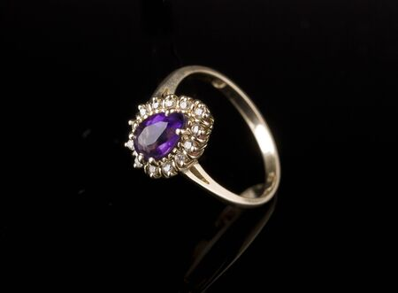 Diamond golden ring reflected on black background Stock Photo - 8383200