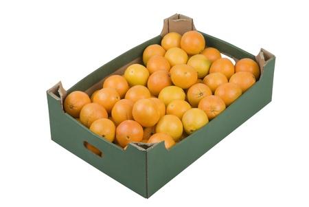 Box of fresh oranges isolated on white background Foto de archivo