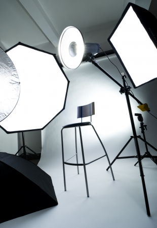 Photo studio setup with lighting equipment (background)