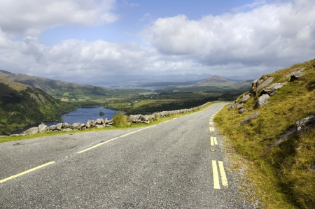 Scenic road in the mountains, Killarney National Park, Ireland photo