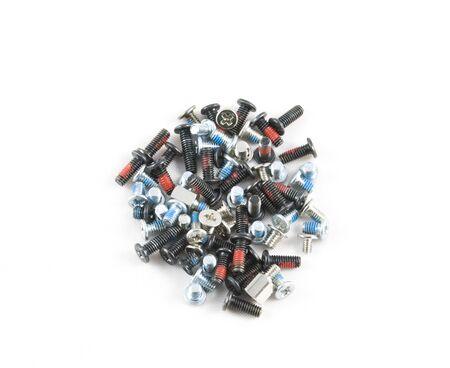 Many fixing machine screws isolated on white photo
