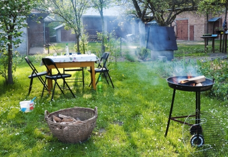 Old-fashioned barbecue in the countryside farm garden photo