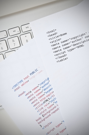HTML programming concept with computer keyboard and html script photo