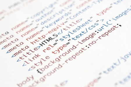 HTML script printed on white paper with shallow depth of field