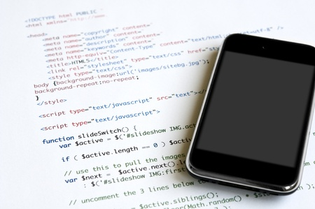 HTML script and modern smartphone with blank screen for copy space Standard-Bild