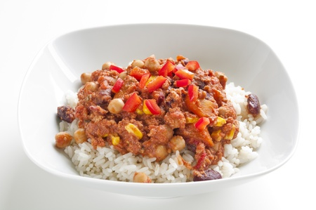 spicy chilli: Rice with chili con carne and red chili peppers