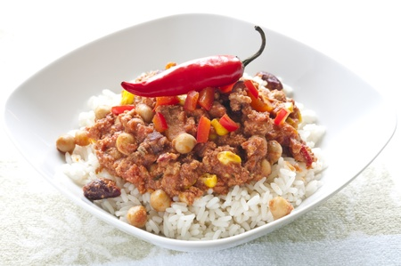 Rice with chili con carne and red chili peppers photo