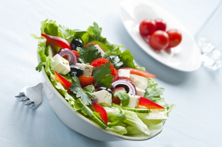 Greek salad with feta, cherry tomatoes and black olives photo