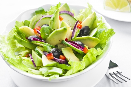 Salad with avocado, black olives, red onion and cucumber Stock Photo
