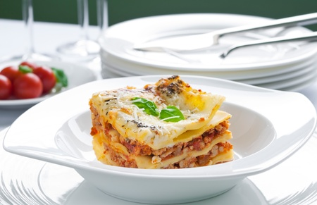 Portion of lasagna with meat topped with parmesan 版權商用圖片