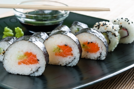 Selection of Japanese sushi arranged on black plate Stock Photo
