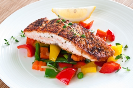 Grilled salmon with vegetables, herbs and lemon photo