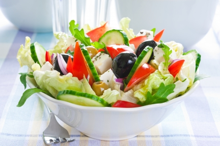 Greek salad with feta cheese and black and green olives photo