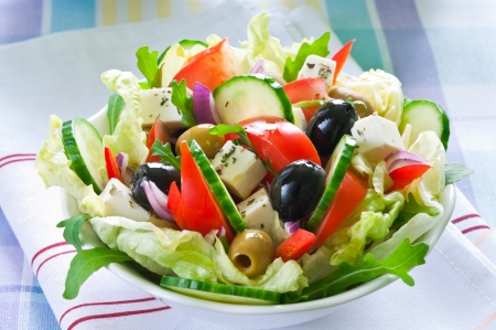 Greek salad with feta cheese and black and green olives