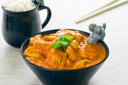 Chicken curry with rice and chopsticks photo