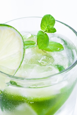 Glass of mojito drink with ice, mint and lime photo
