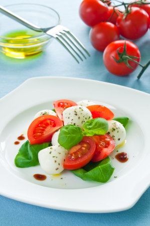 cherry tomatoes: Caprese salad with baby mozzarella and cherry tomatoes Stock Photo