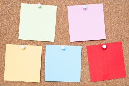 Selection of blank adhesive notes attached to a cork board Stock Photo - 18545089