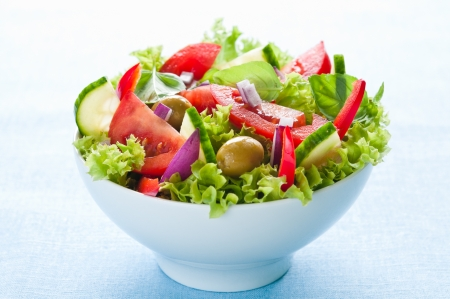 Fresh salad with lettuce, tomato, cucumber and olives Stock Photo