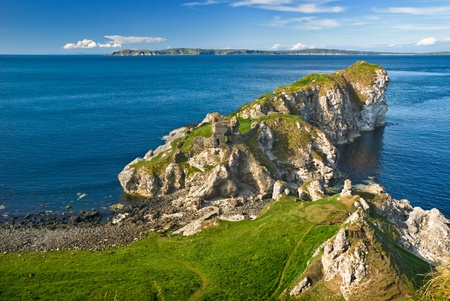 View over cliffs with castle ruins in Northern Ireland, Europe photo