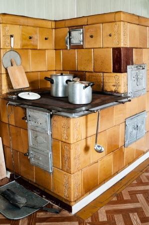 Vintage Kitchen Stove With Aluminium Pots And Other Utensils Photo