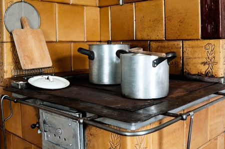 Vintage Kitchen Stove With Aluminium Pots And Other Utensils Stock Photo,  Picture And Royalty Free Image. Image 20891578.