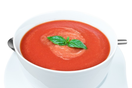tomato soup: Fresh tomato soup with basil in a bowl isolated on white with Work Path