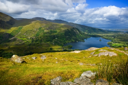 connemara: Scenic view over mountains and lake on sunny day Stock Photo