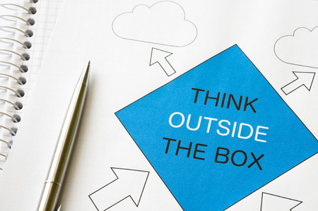 Think outside the box concept graph printed on white paper photo