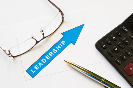 Leadership concept - arrow pointing up graph printed on white paper photo