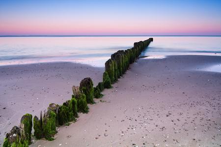 Long exposure shot over breakwater on Baltic Sea shoreline