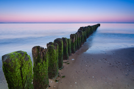 seaview: Long exposure shot over breakwater on Baltic Sea shoreline