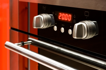 Modern electric oven with digital display and controls