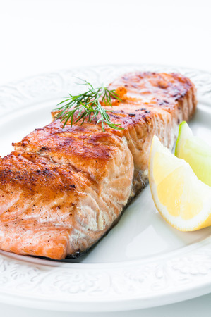salmon dinner: Grilled salmon fillet with lemon, lime and dill Stock Photo