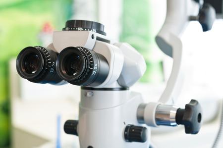 Professional modern microscope equipment at dental office Foto de archivo