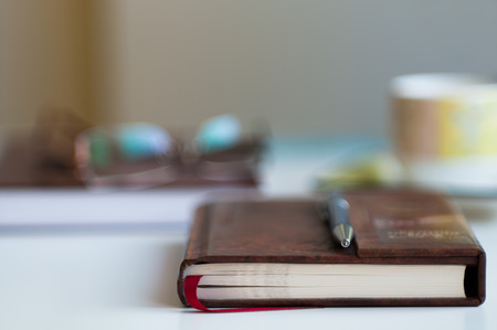 blurred background: Close up of book blurred with very shallow depth of field