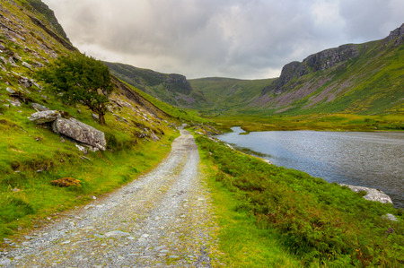 connemara: Beautiful valley on Dingle Peninsula with country road, lake and mountains