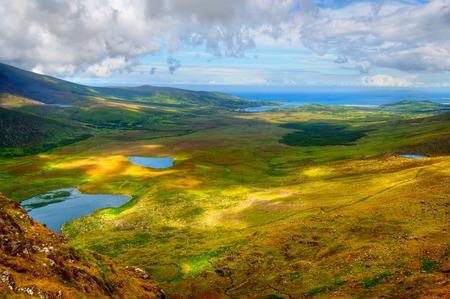 Sunny mountain and lake landscape on Dingle peninsula, Ireland