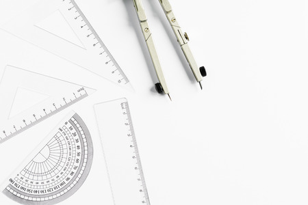 school supplies: Compass and other measuring equipment on white paper