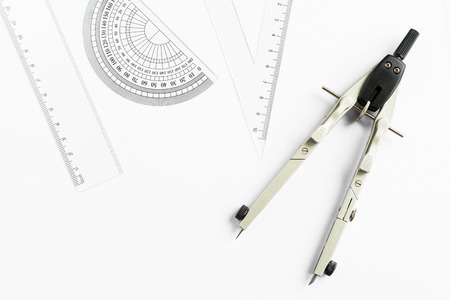 calipers: Compass and other measuring equipment on white paper