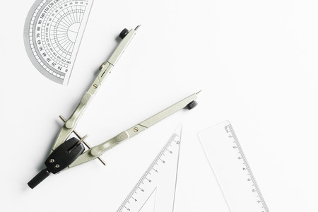 ruler: Compass and other measuring equipment on white paper