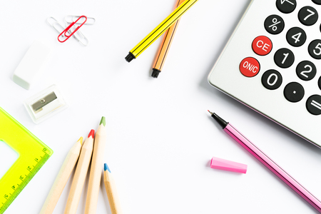 fineliner: School accessories with calculator on white paper background Stock Photo