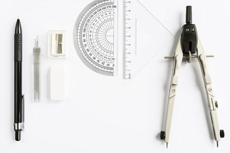 Set of measuring tools with compass, pencil and rulers on white background from above