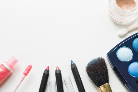 illuminator: Make-up set on white background with copy space
