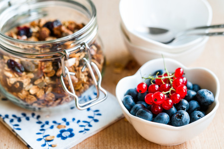 redcurrant: Healthy breakfast with granola, blueberries and redcurrant Stock Photo