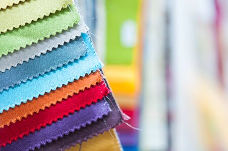 sample: Close-up detail of multicolor fabric textile samples with copy space Stock Photo