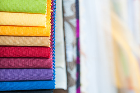 samples: Close-up detail of multicolor fabric textile samples with copy space Stock Photo